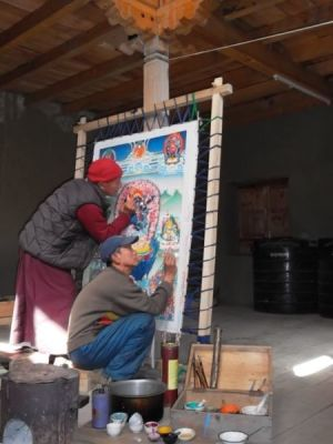 Shashi and Chakra painting a thangka in the library